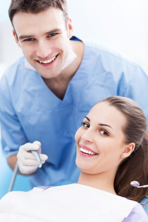 Dentist and patient in dentist office photo