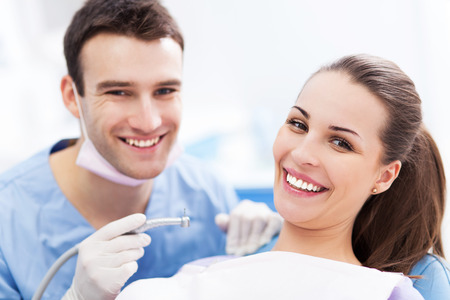 Male dentist and female patient photo