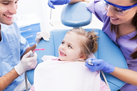 dentistry: Girl having teeth examined at dentists