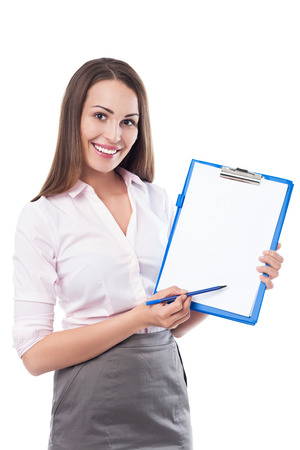 Businesswoman with pen and clipboard
