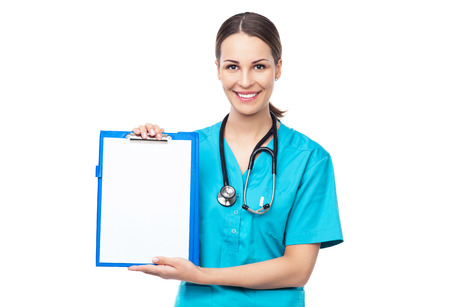 Female doctor holding a clipboard photo