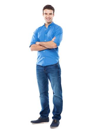Junger Mann, der gegen weißen Hintergrund Standard-Bild - 26027724