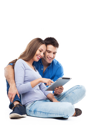women body: Couple using digital tablet Stock Photo