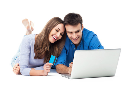 Couple Using Bank Card Online With a Laptop photo