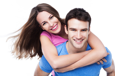 Man giving woman piggyback ride photo