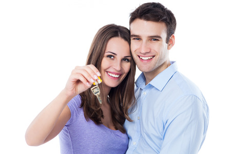 home keys: New home owners with key