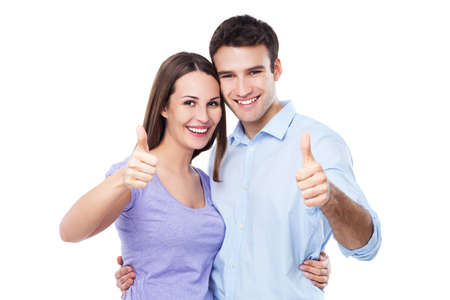 man thumbs up: Young couple with thumbs up