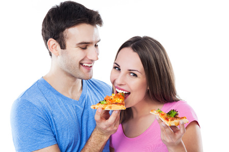 Young couple eating pizza photo