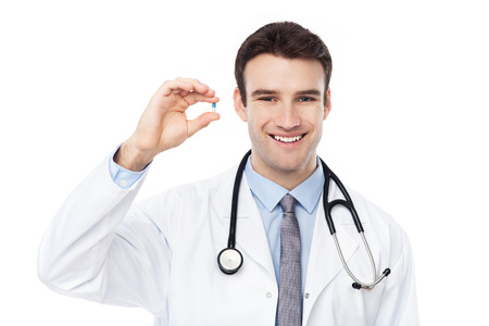 Doctor holding a pill photo