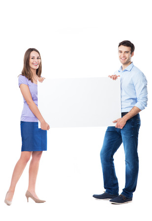 Young couple holding a placard photo