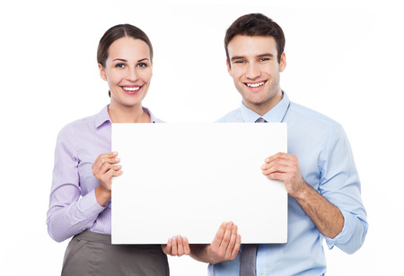 Business couple holding a placard photo