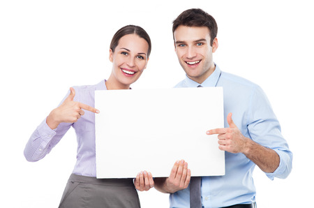 blank board: Business couple holding a placard
