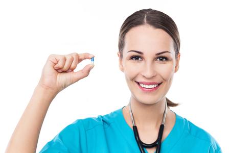 Female doctor holding pill photo