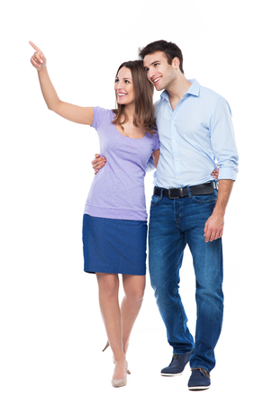 Young couple pointing up Stock Photo