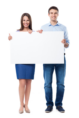 man holding sign: Woman and man holding a placard Stock Photo
