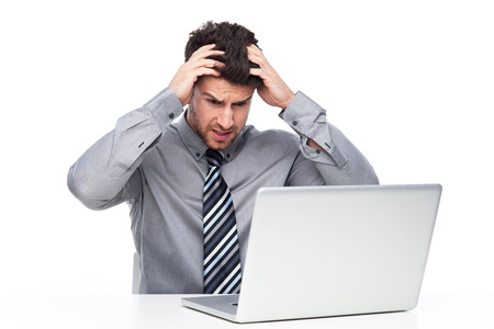 Frustrated Man Staring at Laptop Screen photo