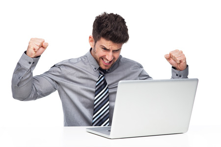 Angry man having problem with his laptop photo