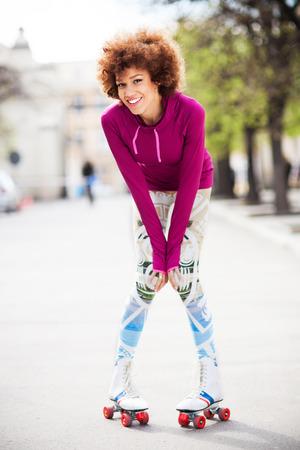 rollerskating: Young woman roller-skating  Stock Photo