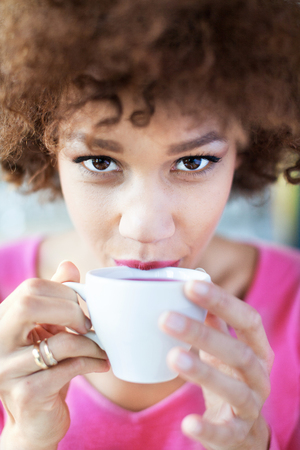 teatime: Afro woman with cup of tea Stock Photo