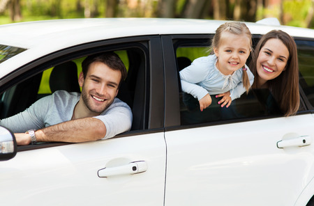 Family sitting in the car looking out windows Stock Photo