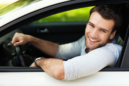 Young man sitting in a car Stock Photo