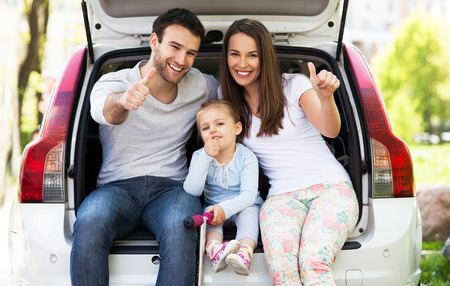 Family in car showing thumbs up Stock Photo