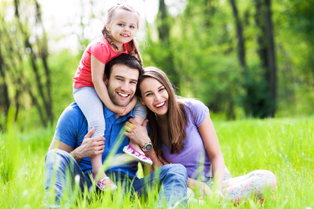 Young Family Bonding in Park Stock Photo - 28423888