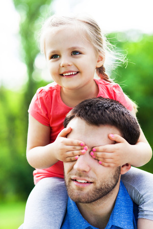 piggyback ride: Father Giving Daughter Piggyback Ride Stock Photo