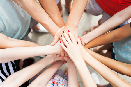 joined hands: Hands joined in unity Stock Photo