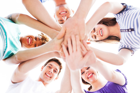 happy team: Friends joining hands Stock Photo