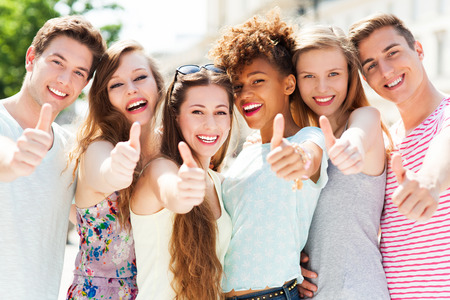 Friends showing thumbs up photo