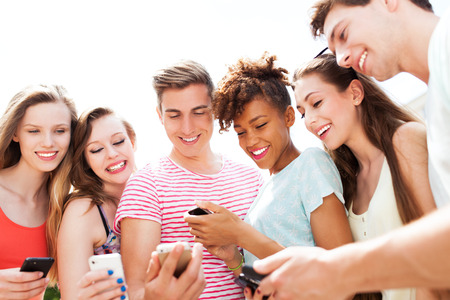 Young people looking at smartphones