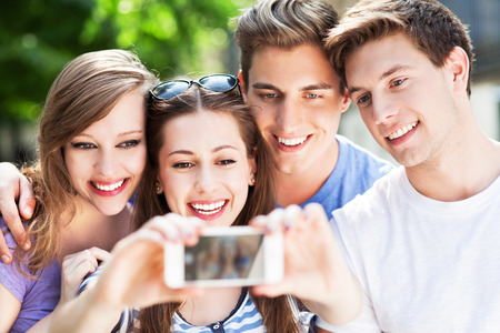 beautiful teen: Friends taking photo of themselves