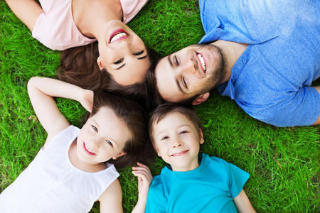 Young family lying on grass photo