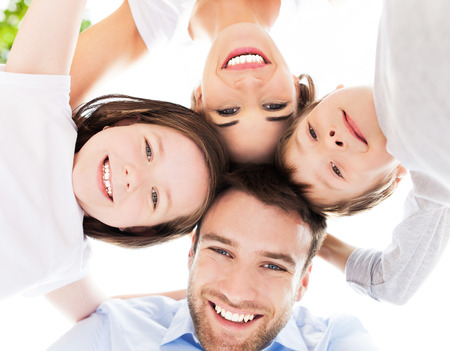 Family smiling together outdoors photo