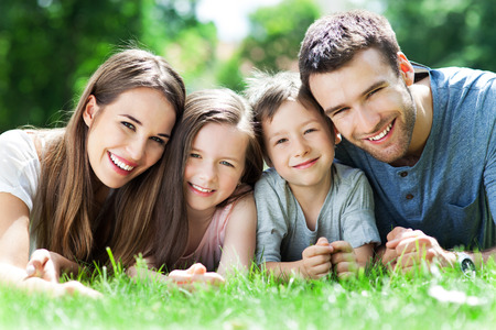 Family outdoors lying on grass  photo