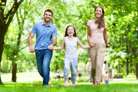 Young Family Having Fun In Park photo