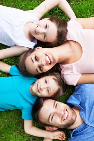 smiling people: Young family smiling Stock Photo