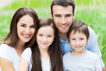 fun day: Young family smiling Stock Photo