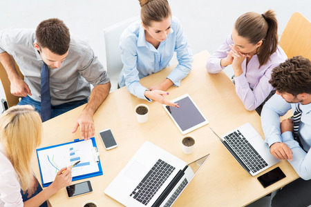 Colleagues working in office, high angle Stock Photo