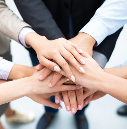 Business people stacking hands