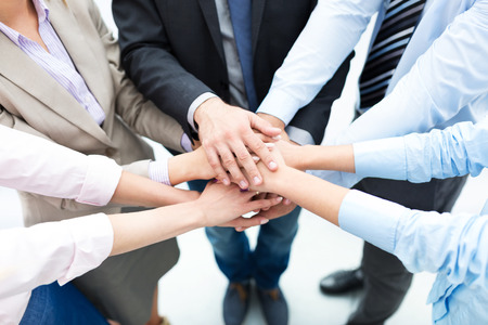 business success: Business people joining hands in circle