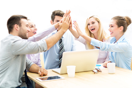huddle: Business people joining hands Stock Photo