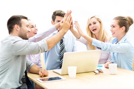 Business people joining hands Standard-Bild