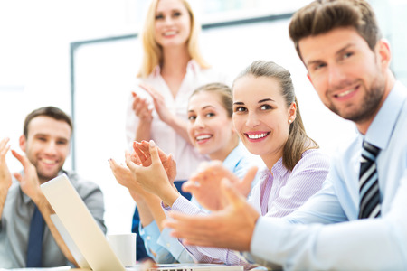 Business team clapping in applause photo