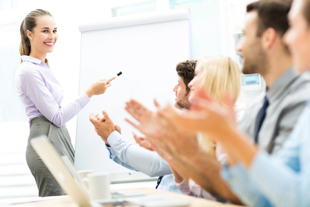 Business people at a presentation, clapping photo