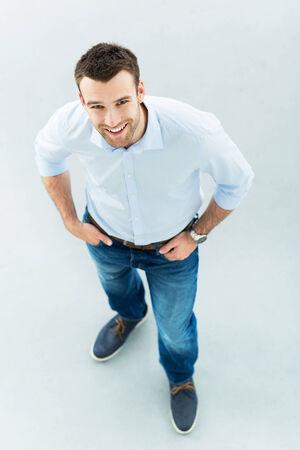 high angle shot: High angle of young man standing