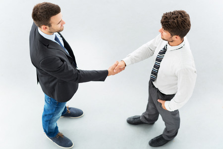 overhead shot: Business associates shaking hands, high angle view Stock Photo