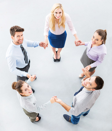 Business people joining hands in circle photo