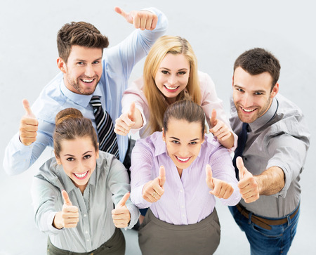 thumbs up: Business group with thumbs up